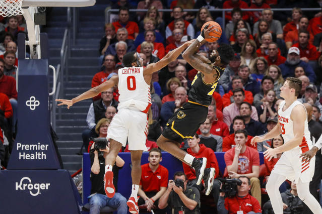 Virginia Commonwealth's Issac Vann (23) shoots against Dayton's Rodney Chatman (0) during the first half of an NCAA college basketball game, Tuesday, Jan. 14, 2020, in Dayton, Ohio. (AP Photo/John Minchillo)