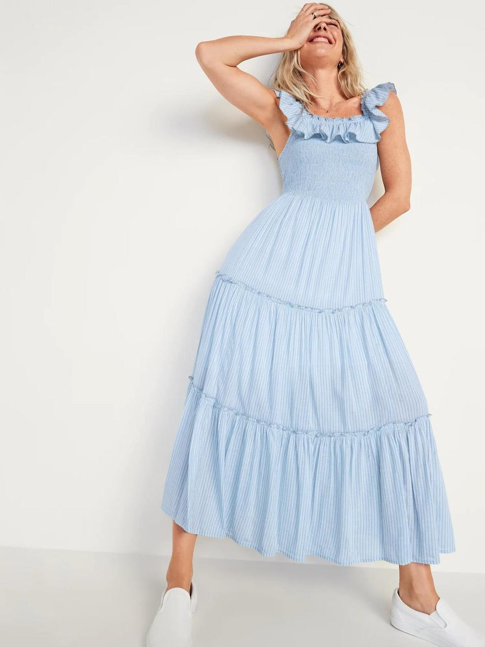 <p>This cute <span>Old Navy Ruffled Smocked-Bodice Striped Sleeveless Maxi Dress</span> ($50) would look great with white sneakers.</p>