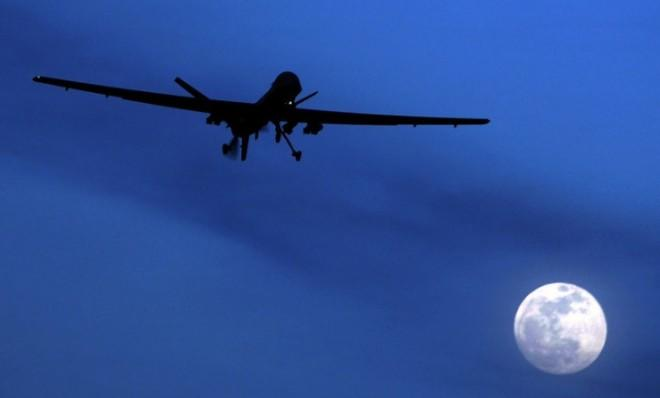 In this 2010 file photo an unmanned U.S. Predator drone flies over Kandahar Air Field, southern Afghanistan.