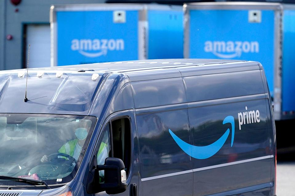 FILE - An Amazon Prime logo appears on the side of a delivery van as it departs an Amazon Warehouse location n Oct. 1, 2020, in Dedham, Mass. Retailers and carriers are preparing for a holiday shipping  surge that could mean delays in holiday gifts.  Amazon has been growing its own delivery network to depend less on UPS and the post office, leasing planes, ordering vans and opening warehouses closer to shoppers to deliver faster.