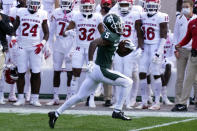 Michigan State wide receiver Jayden Reed (5) runs down the sidelines for a touchdown during the first half of an NCAA college football game against Rutgers, Saturday, Oct. 24, 2020, in East Lansing, Mich. (AP Photo/Carlos Osorio)
