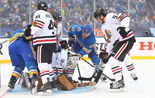 <p>ST. LOUIS, MO – JANUARY 2: Corey Crawford #50 of the Chicago Blackhawks makes a save against Scottie Upshall #10 of the St. Louis Blues during the 2017 Bridgestone NHL Winter Classic at Busch Stadium on January 2, 2017 in St. Louis, Missouri. (Photo by Dilip Vishwanat/Getty Images) </p>