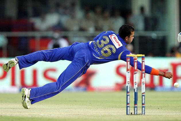 Sree Sreesanth of Rajasthan Royals dives to make a stop off his own bowling during match 4 of the Pepsi Indian Premier League between Delhi Daredevils and the Rajasthan Royals held at the Feroz Shah Kotla Stadium, Delhi on the 6th April 2013..Photo by Shaun Roy-IPL-SPORTZPICS ..Use of this image is subject to the terms and conditions as outlined by the BCCI. These terms can be found by following this link:..https://ec.yimg.com/ec?url=http%3a%2f%2fwww.sportzpics.co.za%2fimage%2fI0000SoRagM2cIEc&t=1490500486&sig=MlLKK2PyZcXMyvq5ootKlA--~C
