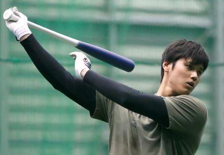 FILE PHOTO - Japanese pitching and hitting star Shohei Ohtani works out ahead of his move to the Los Angeles Angels in Kamagaya
