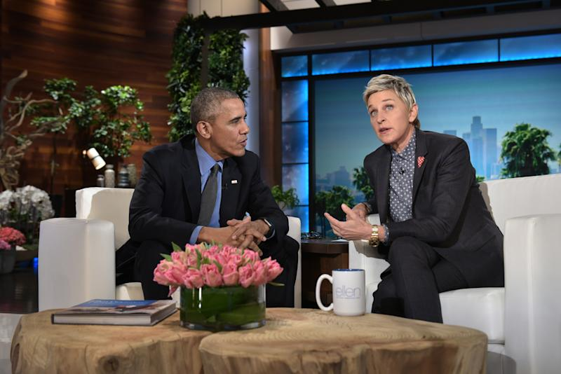 US President Barack Obama and talk show host Ellen DeGeneres speak during a break in the taping of The Ellen DeGeneres show at Warner Brothers Studios in Burbank, California on February 11, 2016. / AFP / MANDEL NGAN (Photo credit should read MANDEL NGAN/AFP via Getty Images)