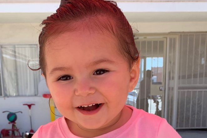 A photo of two-year-old June Love Agosto – who died in her mum's hot car in Torrance, California – wearing a pink T-shirt.