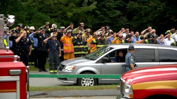 PHOTO: Firefighters salute outside of the Medical Examiner's Office after a firefighter was killed in an explosion in Farmington, Maine, Sept. 16, 2019. (WGME )