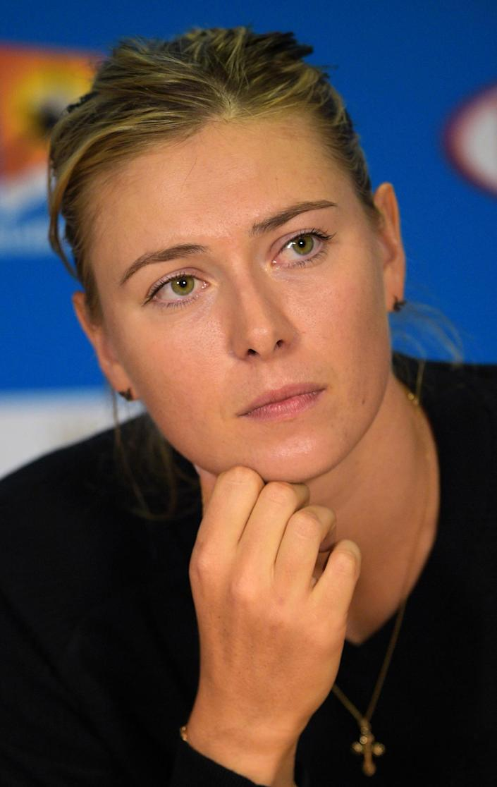 Maria Sharapova tells a news conference after her defeat she is a fighter and will work hard to keep putting herself in the position to beat the American (AFP Photo/Greg Wood)