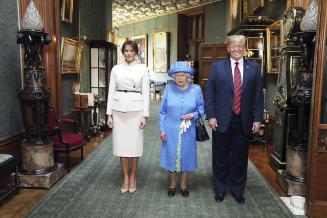 <p>Britain's Queen Elizabeth II , center, poses for a photo with US President Donald Trump and his wife, Melania, in the Grand Corridor during their visit to Windsor Castle, Friday, July 13, 2018, in Windsor, England. (Photo: Steve Parsons/Pool Photo via AP) </p>