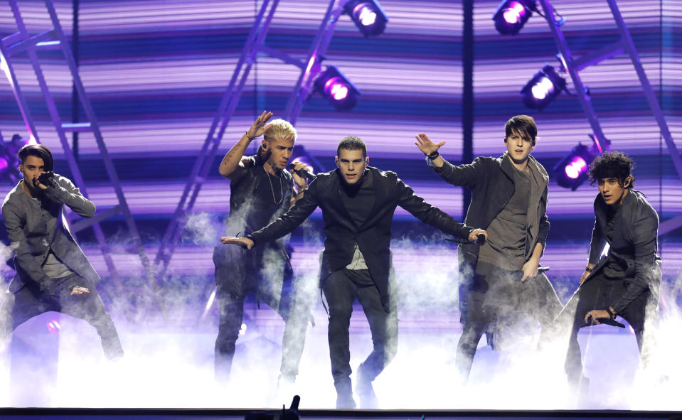 """FILE - This April 26, 2018, file photo shows CNCO performing """"Mamita"""" at the Billboard Latin Music Awards in Las Vegas on. The Latin American boy band CNCO is downsizing. The group announced on its official Instagram page Sunday, May 9, 2021, that 22-year-old Joel Pimentel is leaving the band, making the successful quintet a quartet.(Photo by Eric Jamison/Invision/AP, File)"""