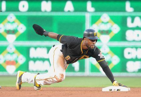 Jul 9, 2018; Pittsburgh, PA, USA; Pittsburgh Pirates base runner Starling Marte (6) steals second base in the fourth inning against the Washington Nationals at PNC Park. Mandatory Credit: Philip G. Pavely-USA TODAY Sports