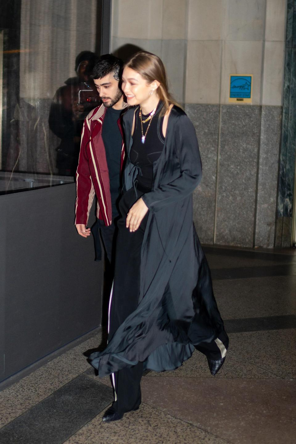 Gigi and Zayn were seen together in NYC wearing different takes on all-back outfits. While Zayn opted for a pop of color with his jacket, Gigi favored texture and length play.