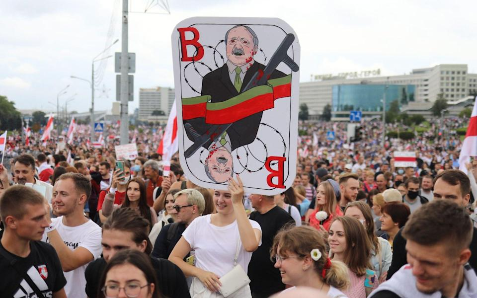 Belarus opposition supporters attend a rally to protest against the disputed August 9 presidential elections - AFP