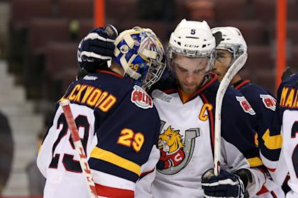 OTTAWA, ON - MARCH 13: Aaron Ekblad #5 congratulates teammate Mackenzie Blackwood #29 of the Barrie Colts following a win against the Ottawa 67's during an OHL game at Canadian Tire Centre on March 13, 2014 in Ottawa, Ontario, Canada. (Photo by Jana Chytilova/Freestyle Photography/Getty Images)