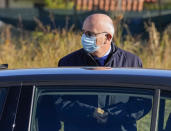 Prosecutor Sergio Colaiocco arrives at the Rebibbia prison in Rome, Thursday, Oct. 14, 2021, to preside over the first hearing of the trial for the death of Italian doctoral student Giulio Regeni, who disappeared for several days in January 2016 before his body was found on a desert highway north of the Egyptian capital. Italian prosecutors have formally put four high-ranking members of Egypt's security forces under investigation for their alleged roles in the slaying. (AP Photo/Andrew Medichini)