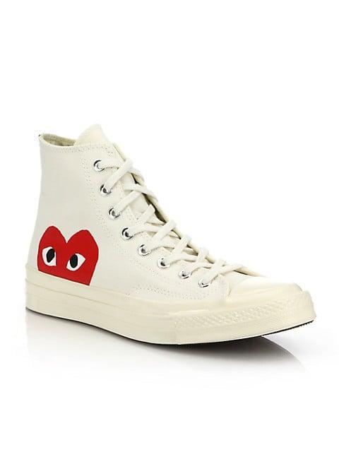 """<p><span>Comme des Garcons Play Peek-A-Boo High-Top Canvas Sneakers</span> ($150)</p> <p>Converse are obviously a sneaker staple but I love the Comme des Garçons collab. These are so easy to style with anything but still have a pop of personality and color thanks to the CDG logo."""" - Kelsey Kennick, editorial operations manager</p>"""