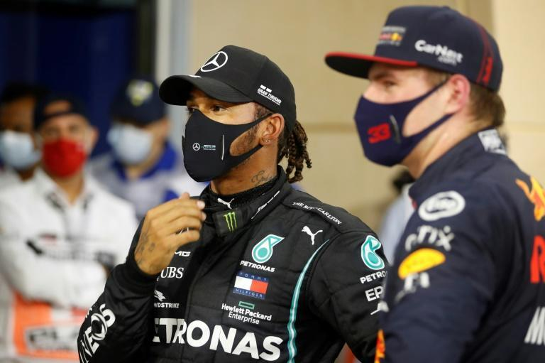 Hamilton (left) with Verstappen, the man perhaps best placed to end his F1 reign