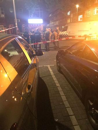 People gather at the scene where police are investigating a van (not pictured) with Spanish licence plates containing gas bottles that was found near a concert hall in Rotterdam, in this handout picture obtained by Reuters August 23, 2017. Social Media/Handout via REUTERS   ATTENTION EDITORS - THIS IMAGE HAS BEEN SUPPLIED BY A THIRD PARTY. NO RESALES. NO ARCHIVE.