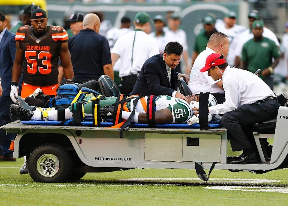 Lorenzo Mauldin of the New York Jets is carted off the field on a stretcher during the fourth quarter of their game against the Cleveland Browns, at MetLife Stadium in East Rutherford, New Jersey, on September 13, 2015 (AFP Photo/Rich Schultz)