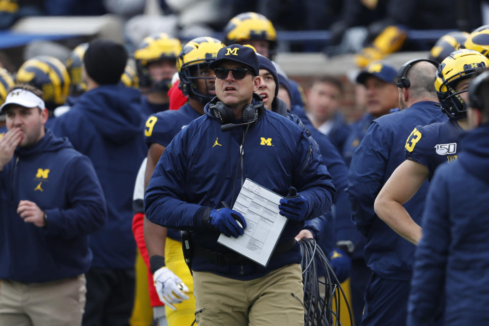 Michigan head coach Jim Harbaugh watches against Ohio State in the first half of an NCAA college football game in Ann Arbor, Mich., Saturday, Nov. 30, 2019. (AP Photo/Paul Sancya)