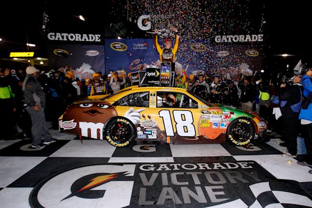 RICHMOND, VA - APRIL 28: Kyle Busch, driver of the #18 M&M's Ms. Brown Toyota, celebrates in Victory Lane after winning the NASCAR Sprint Cup Series Capital City 400 at Richmond International Raceway on April 28, 2012 in Richmond, Virginia. (Photo by Sean Gardner/Getty Images for NASCAR)