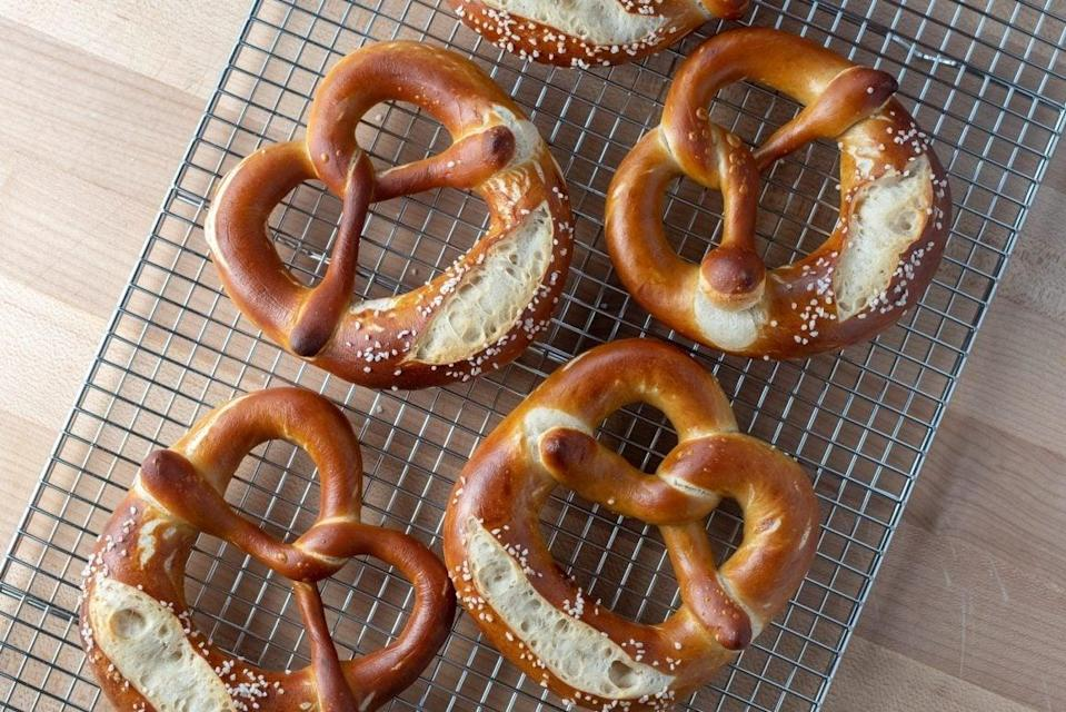 """<h2><a href=""""https://www.theperfectloaf.com/seriously-soft-sourdough-pretzel/"""" rel=""""nofollow noopener"""" target=""""_blank"""" data-ylk=""""slk:Soft Sourdough Pretzel"""" class=""""link rapid-noclick-resp"""">Soft Sourdough Pretzel</a></h2> <br>If you've mastered baking cakes and brownies, making a pretzel is your next step to being on <a href=""""https://www.refinery29.com/en-gb/2018/08/208244/easy-vegan-brownies"""" rel=""""nofollow noopener"""" target=""""_blank"""" data-ylk=""""slk:The Great British Bake Off"""" class=""""link rapid-noclick-resp""""><em>The Great British Bake Off</em></a>. This recipe is a great introduction to the world of dough making. <br><br>Recipe here by <a href=""""https://www.theperfectloaf.com/seriously-soft-sourdough-pretzel/"""" rel=""""nofollow noopener"""" target=""""_blank"""" data-ylk=""""slk:The Perfect Loaf"""" class=""""link rapid-noclick-resp"""">The Perfect Loaf</a><br><br><br>"""