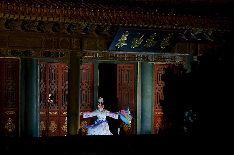 A Peking Opera artist performs dance in the Forbidden City which lit up by lights during the Lantern Festival in Beijing, Tuesday, Feb. 19, 2019. (Photo: Andy Wong/AP)