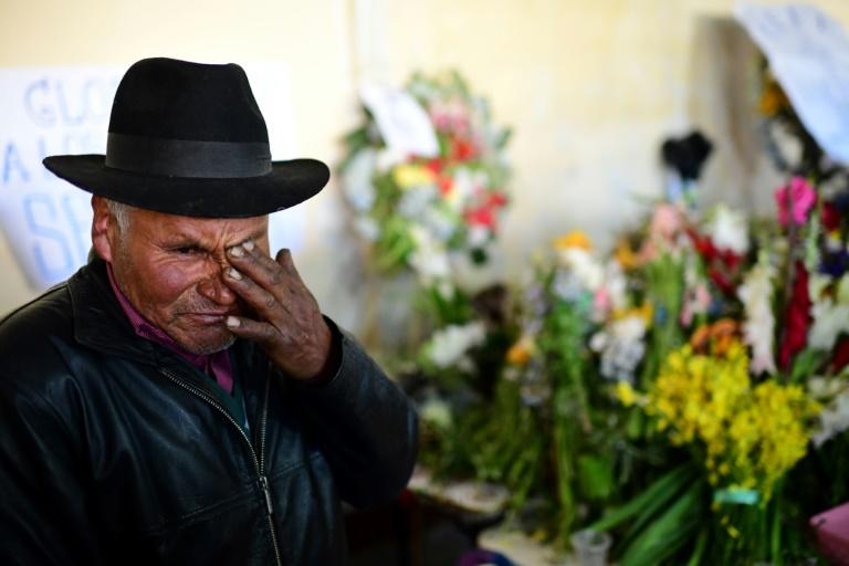 A man mourns during the funeral for five supporters of Bolivia's ex-president Evo Morales, killed when security forces lifted a siege on a fuel plant, in El Alto on November 21, 2019