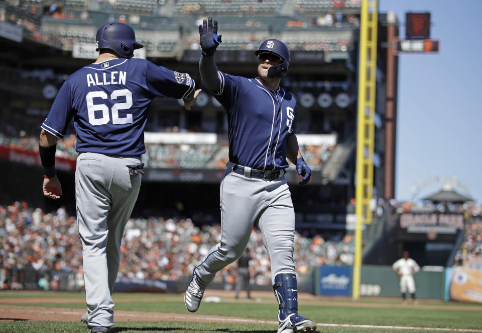 San Diego Padres' Ty France, right, celebrates with Austin Allen (62) after hitting a three-run home run off San Francisco Giants' Fernando Abad in the sixth inning of a baseball game Sunday, Sept. 1, 2019, in San Francisco. (AP Photo/Ben Margot)