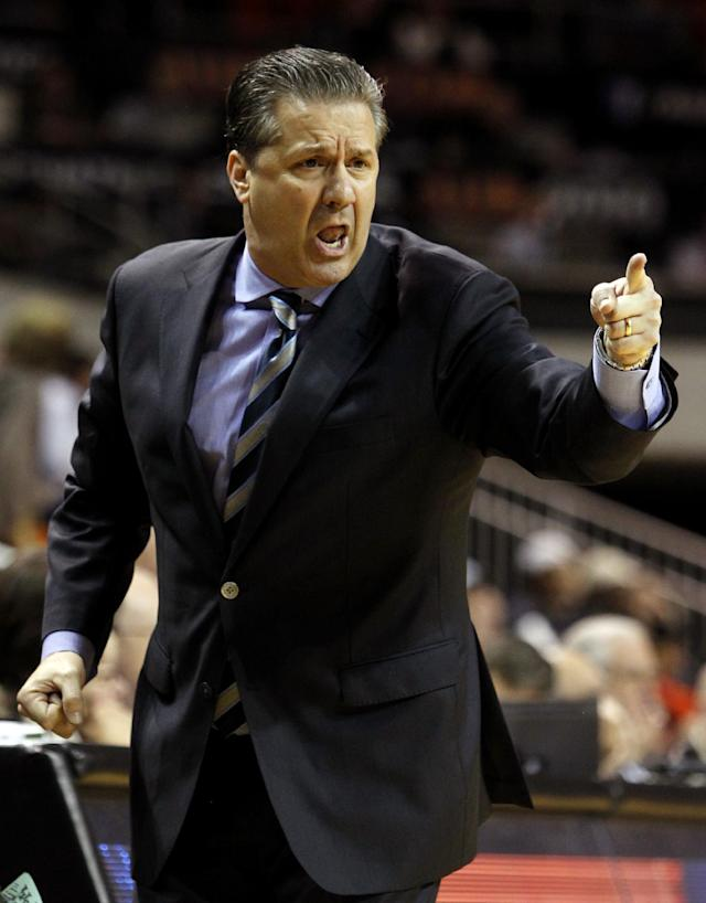 Kentucky coach John Calipari reacts to a turnover during the second half of an NCAA basketball game against Auburn, Wednesday, Feb. 12, 2014, in Auburn, Ala. Kentucky defeated Auburn 64-56