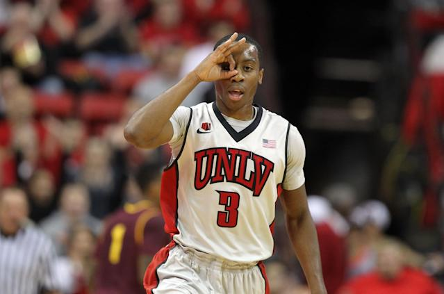UNLV's Kevin Olekaibe gestures after sinking a three during the first half of an NCAA college basketball game against Arizona State on Tuesday, Nov. 19, 2013, in Las Vegas. (AP Photo/Isaac Brekken)