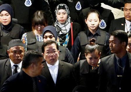 Indonesian Siti Aisyah and Vietnamese Doan Thi Huong, who are on trial for the killing of Kim Jong Nam, the estranged half-brother of North Korea's leader, are escorted as they revisit the Kuala Lumpur International Airport 2 in Sepang, Malaysia October 24, 2017. REUTERS/Lai Seng Sin