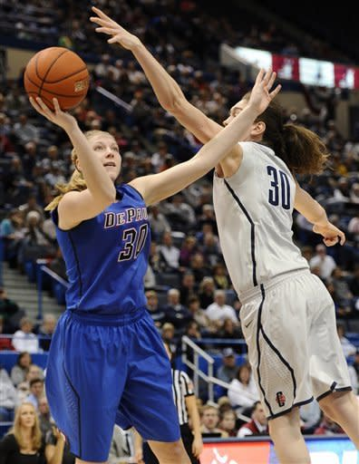 DePaul's Megan Podkowa shoots over Connecticut's Breanna Stewart in the first half of an NCAA college basketball game in the quarterfinals of the Big East Conference women's tournament in Hartford, Conn in Hartford, Conn., Sunday, March 10, 2013. (AP Photo/Jessica Hill)
