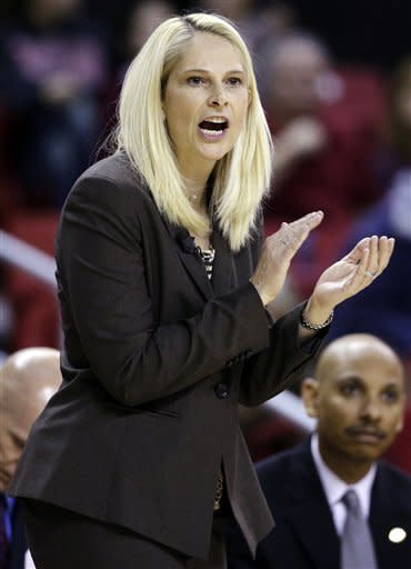 Maryland head coach Brenda Frese reacts after a play in the second half of an NCAA college basketball game against Virginia in College Park, Md., Thursday, Dec. 6, 2012. Maryland won 79-55. (AP Photo/Patrick Semansky)