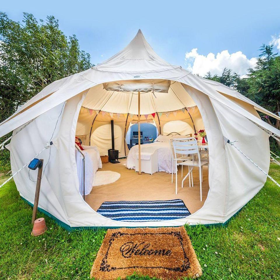 "<p><strong>Lotus Belle</strong></p><p>lotusbelle.com</p><p><strong>$2800.00</strong></p><p><a href=""https://lotusbelle.com/collections/16ft-lotus-belle-tents/products/16ft-lotus-belle-outback-deluxe"" rel=""nofollow noopener"" target=""_blank"" data-ylk=""slk:Shop Now"" class=""link rapid-noclick-resp"">Shop Now</a></p><p>Grab your <a href=""https://go.redirectingat.com?id=74968X1596630&url=https%3A%2F%2Fwww.walmart.com%2Fip%2FORCA-Chastertini%2F107370541&sref=https%3A%2F%2Fwww.bestproducts.com%2Ffitness%2Fequipment%2Fg3197%2Fglamping-luxury-tents%2F"" rel=""nofollow noopener"" target=""_blank"" data-ylk=""slk:glamping martini glass"" class=""link rapid-noclick-resp"">glamping martini glass</a> and settle in for a while. If this tent seems like something out of a fairytale, that's because it practically is. This 16x16-foot bell-shaped tent is big enough to fit six (yes, six) twin-sized mattresses, or for six people to practice yoga comfortably. </p><p>This deluxe tent has two mesh windows and two roof vents to maximize airflow, an oversized zip-up front door that is wide enough for a queen-sized bed to fit through, and plenty of exterior tie-downs to keep things secure if the wind picks up. </p><p>This Lotus Belle is the definition of a glamping tent, with so much comfort that you might never want to go home.</p><p><strong>More:</strong> <a href=""https://www.bestproducts.com/fun-things-to-do/a1271/luxury-glamping-with-hot-tubs/"" rel=""nofollow noopener"" target=""_blank"" data-ylk=""slk:These Glamping Destinations Are What Dreams Are Made Of"" class=""link rapid-noclick-resp"">These Glamping Destinations Are What Dreams Are Made Of</a></p>"