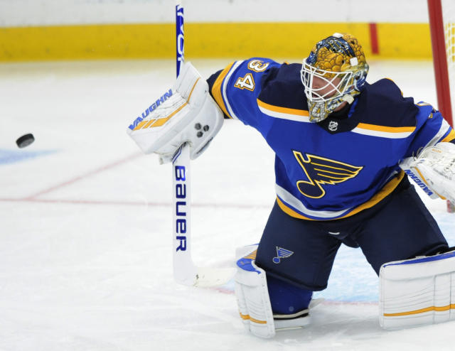 St. Louis Blues goalie Jake Allen (34) blocks a shot against the Buffalo Sabres during the first period of an NHL hockey game, Thursday, Dec. 27, 2018, in St. Louis. (AP Photo/Bill Boyce)