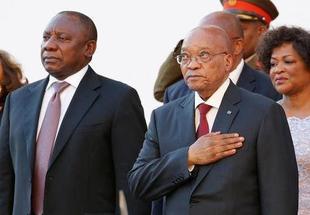 FILE PHOTO: South Africa's Deputy President Cyril Ramaphosa and President Jacob Zuma stand during the playing of the national anthem at the opening of Parliament in Cape Town, February 11, 2016. REUTERS/Mike Hutchings/File Photo