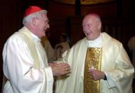 FILE - In this Jan. 21, 2001 file photo, Cardinal-designate Theodore E. McCarrick, right, is congratulated by Cardinal William Keeler of Baltimore before a Sunday evening Mass at the Basilica of the National Shrine of the Immaculate Conception in Washington. Pope John Paul II elevated McCarrick, the current archbishop of Washington, to cardinal. (AP Photo/Susan Walsh, File)