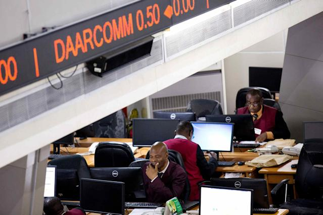 Traders work at the Nigerian Stock Exchange in Lagos, February 13, 2015. REUTERS/Joe Penney