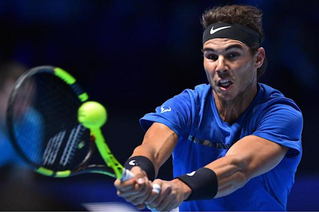 Rafael Nadal returns against David Goffin during their singles match on day two of the ATP World Tour Finals tennis tournament at the O2 Arena in London (AFP Photo/Glyn KIRK )
