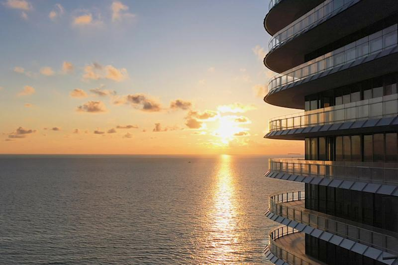 The balconies of the building have uninterrupted views of the ocean.
