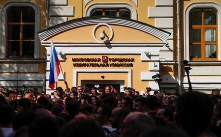People attend a rally against alleged violations ahead of elections to Moscow City Duma in Moscow