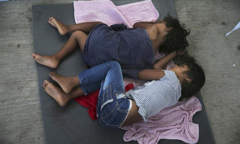 Migrant children sleep on a mattress on the floor of the AMAR migrant shelter in Nuevo Laredo, Mexico, in July 2019.