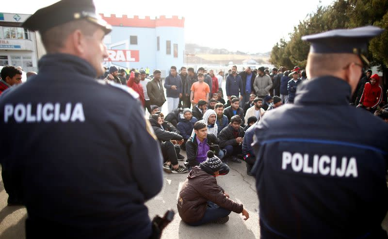 Migrants are stoped by police while trying to block road in front of the refugee camp Miral in Velika Kladusa