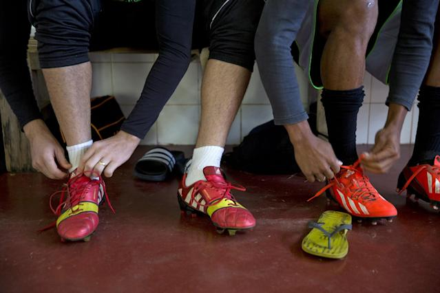 In this May 28, 2014 photo, players from the Presidente Prudente soccer club lace up their shoes for a training session in Presidente Prudente, Brazil. In Brazil, the best players leave quickly for offers to play in other nations. (AP Photo/Andre Penner)