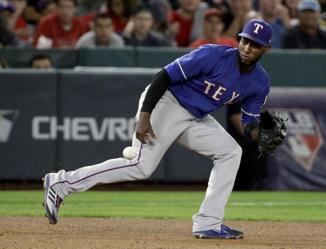 Texas Rangers shortstop Jurickson Profar fields a ball hit by Los Angeles Angels' Joe Hudson during the fifth inning of a baseball game in Anaheim, Calif., Tuesday, Sept. 25, 2018. Hudson was out at first. (AP Photo/Chris Carlson)