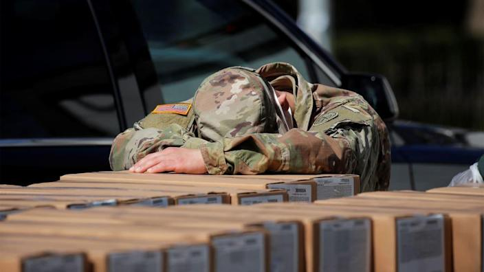 """<div class=""""inline-image__title""""> HEALTH-CORONAVIRUS/USA-NEW YORK </div> <div class=""""inline-image__caption""""> <p>""""A U.S. Army National Guard member rests on boxes of preferred meals that were being distributed free to residents in the East Harlem section of Manhattan during the outbreak of the coronavirus disease (COVID-19) in New York City, New York, U.S., April 1, 2020. """"</p> </div> <div class=""""inline-image__credit""""> Brendan McDermid/Reuters </div>"""