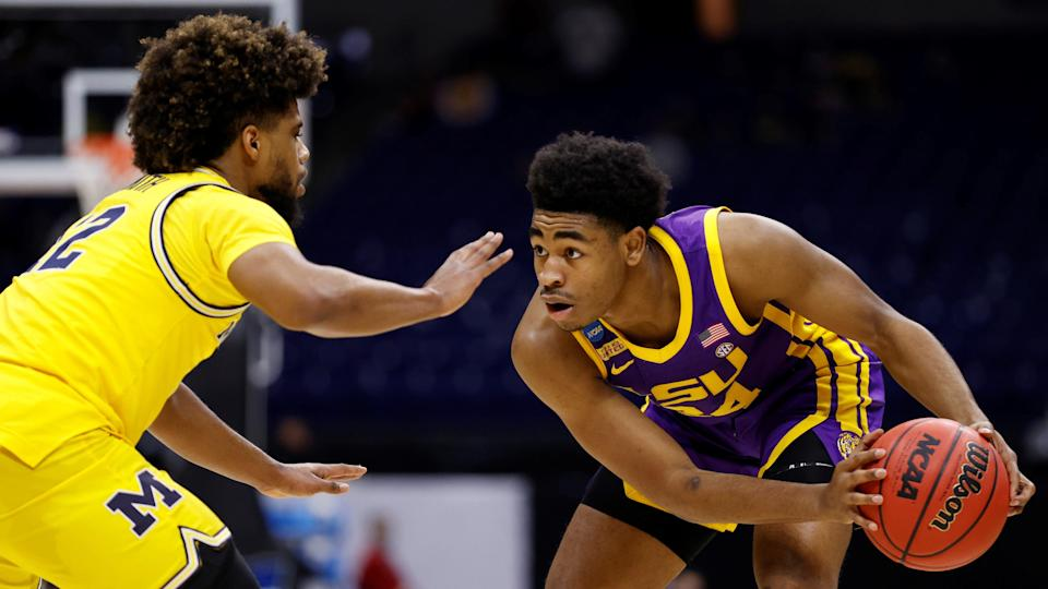 INDIANAPOLIS, INDIANA - MARCH 22: Cameron Thomas #24 of the LSU Tigers handles the ball against Mike Smith #12 of the Michigan Wolverines in the second round game of the 2021 NCAA Men's Basketball Tournament at Lucas Oil Stadium on March 22, 2021 in Indianapolis, Indiana. (Photo by Jamie Squire/Getty Images) ORG XMIT: 775630329 ORIG FILE ID: 1308515733