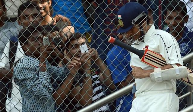 Indian cricketer Sachin Tendulkar walks in to bat for his state team during the Ranji Trophy match between Mumbai and Railways at the Wankhede stadium in Mumbai on November 2, 2012. Tendulkar made a rare appearance in domestic four-day cricket Ranji trophy game to gain match practice ahead of the home Test series against England. The 39-year-old, the world's leading scorer in both Test and one-day cricket, whose last Ranji appearance was in 2009, struggled in a home Test series against New Zealand in August-September when he scored just 63 runs in three innings. AFP PHOTO/ INDRANIL MUKHERJEE