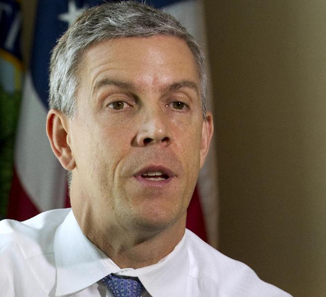 FILE - This July 19, 2012 file photo shows Education Secretary Arne Duncan during an interviewed wth The Associated Press in Washington. Loose ends and thorny partisan tensions on education await the next Congress and President Barack Obama's second term. First up is the fiscal cliff, which will slash billions from the Department of Education's budget if lawmakers don't act this year. (AP Photo/Jacquelyn Martin, File)